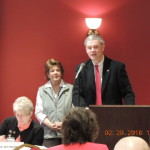 State Representative Matt Baker speaking as TCCRW President Susan Bunn looks on.